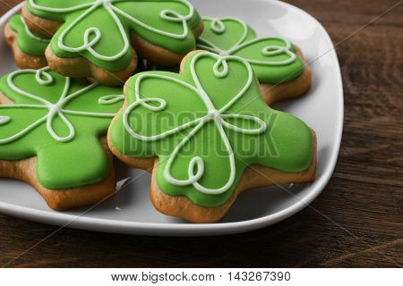 Decorative cookies on plate. Saint Patrics Day concept