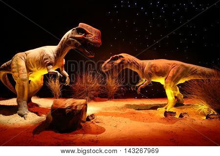 MOSCOW - JAN 30, 2015: Two dinosaurs (Dilophosaurus) at Show of dinosaurs in pavillion of VDNKH