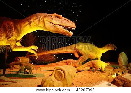 MOSCOW - JAN 30, 2015: Five dinosaurs at Show of dinosaurs in pavillion of VDNKH