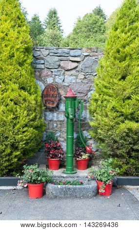 Vintage water-pump in old village in the countryside Ireland