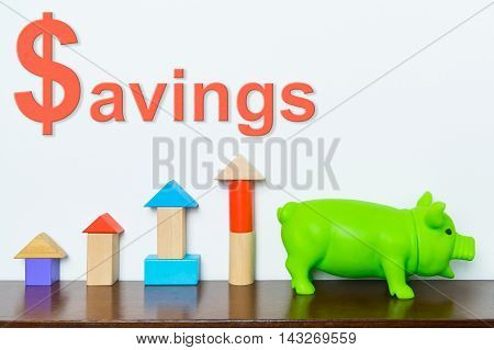 Colorful Savings concept with toy block graphic and piggy bank.
