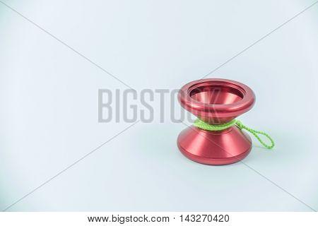 Red yo yo isolated on white background