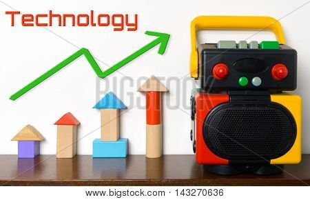 Technology rising graph on colorful educational toy.