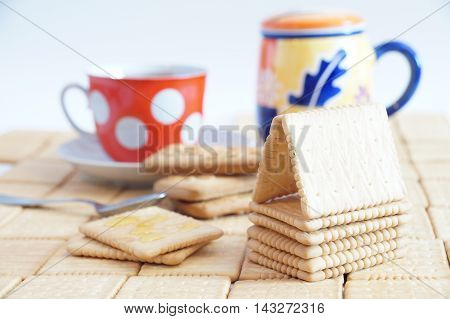 Cracker house and crackers with honey for breakfast. Crackers with coffee.