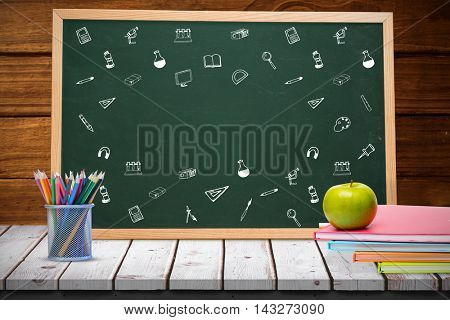 School icons against composite image of black board Composite image of black board against wooden planks