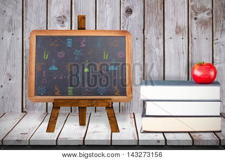School subjects doodles against composite image of black board Composite image of black board against wooden planks