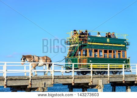Victor Harbor South Australia - April 4 2015: People riding the Horse Drawn Tram from the Granite Island to the main land. Granite Island attracts many tourists all year around.