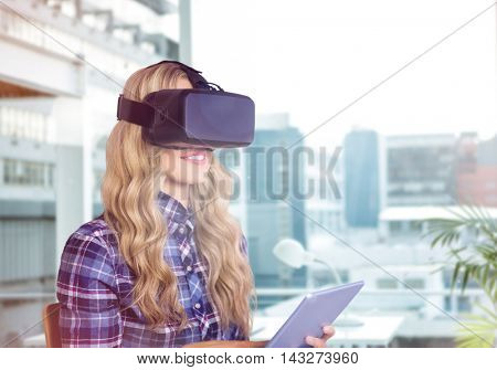 Pretty casual worker using oculus rift against working desk in a office