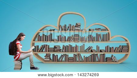 Student reading book in library against blue vignette background