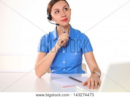 Side view of a beautiful consultant with microphone and headphone.