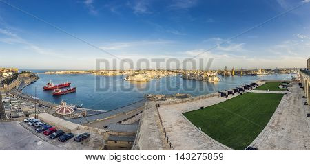 Valletta, Malta - Panoramic skyline view of the Grand Harbor of Valletta from Upper Barrakka Gardens at daylight with blue sky