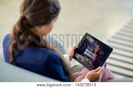 Login screen with dark-haired woman with coffee and laptop against woman using digital tablet
