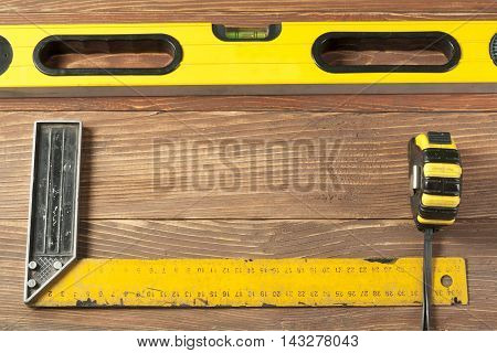 Set of measuring tools wooden table. meter measuring line construction level and square ruler maintenance concept