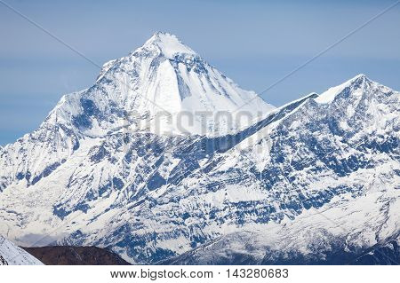 Summit of mount Dhaulagiri from Thorong La Pass on Round Annapurna trek Annapurna Circuit Mustang Nepal.