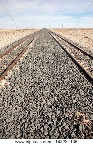 Railroad Tracks Into The Distance