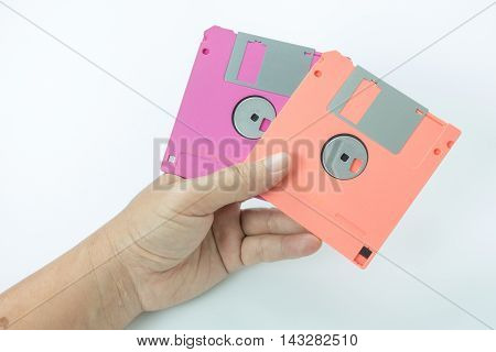 floppy disk in hands on the white background