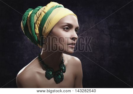 girl in color turban with a green jewelery on his neck