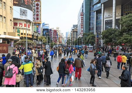 Shanghai China - March 26 2016: Tourists walking in Nanjing Road one of the world's busiest shopping streets.