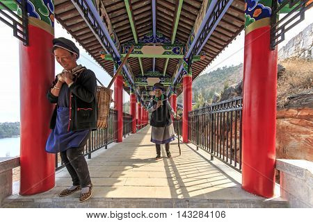 Heqing China - March 16 2016: Bayi women walking in the complex of the Heyang Temple in Heqing Yunnan in China