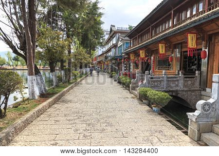 Heqing, China - March 16, 2016: Tourists Walking In The Center Of Heqing Village.