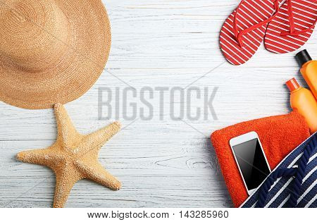 Sun protection accessories on wooden background