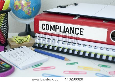 Compliance word on file with office background