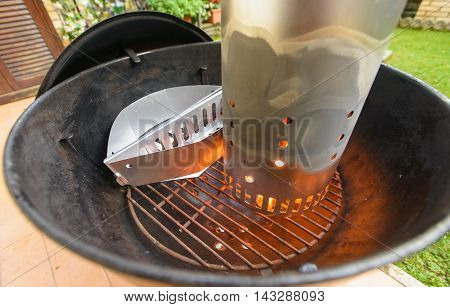 preparing briquette and barbecue for grilling meat