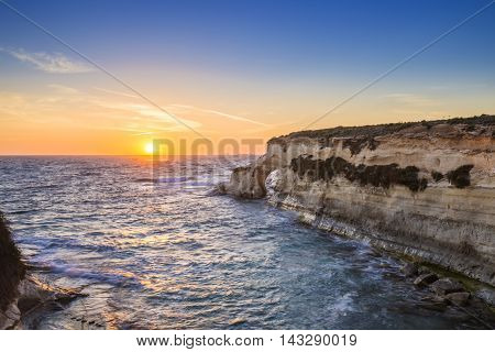Malta sunrise at St.Thomas bay with clear blue sky