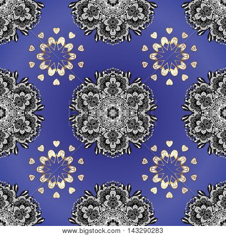 Blue colorful ornament of mandala on a dark round blue background.