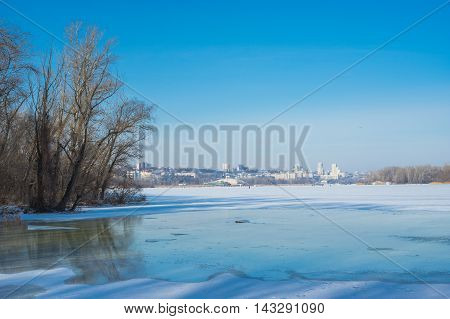 Winter landscape in central Ukraine - view to Dnepropetrovsk city from Dnepr river.