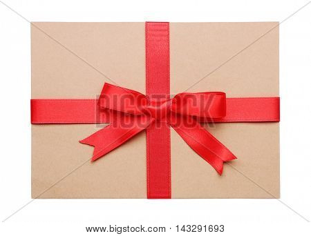 Gift card with a red ribbon isolated on white