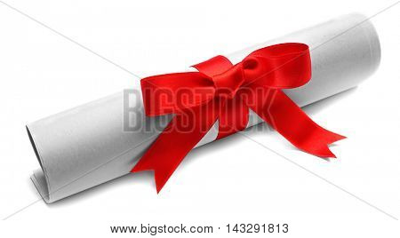 Rolled paper tied with red ribbon isolated on white