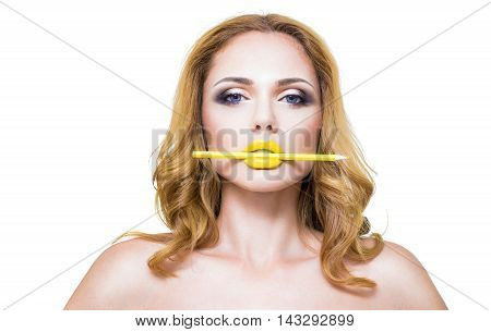 Part of attractive woman's face with fashion yelow lips makeup.
