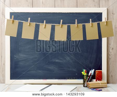 seven sheets of paper hanging and blackboard in background