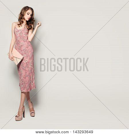 Glamorous Fashion Model Woman Standing on Background