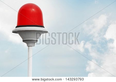 Red lamp post on sky background