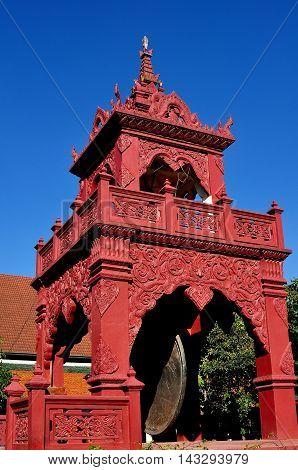 Lamphun Thailand - December 28 2012: Red drum and bell tower at Wat Phra That Haripunchai Maha Viham
