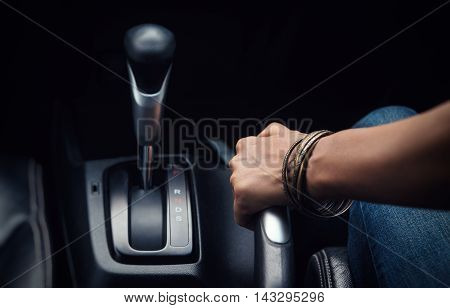 Image of pulling handbrake on the carfocuson hand