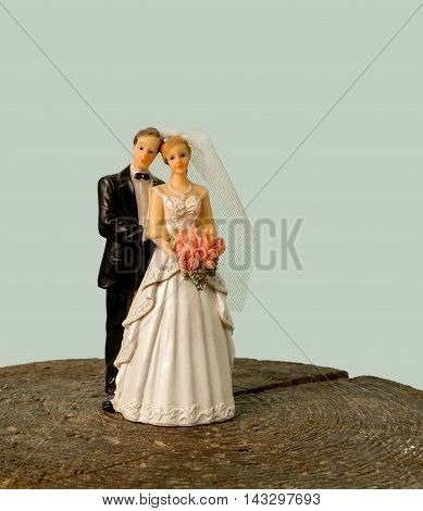 Wedding figurines of a bride and her groom. Marriage dolls
