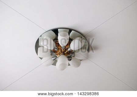 Ceiling lamp on white ceiling in home