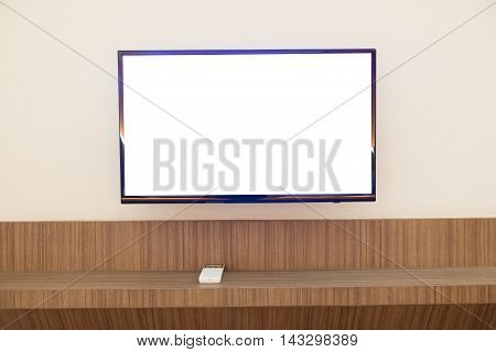 Wall mounted TV and cabinet underneath in home