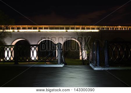 White Stone Bridge In Park At Night