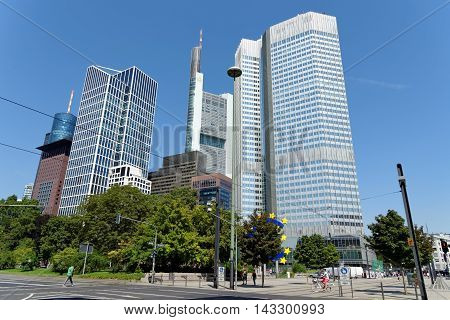 FRANKFURT AM MAIN GERMANY - AUGUST 7 2015: Financial district skyscrapers on Willi-Brandt-Platz square - Main tower Japan Center Taunus tower Commerzbank Eurotower.