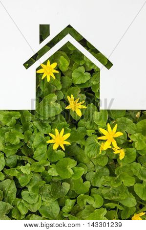 Paper house against green background. Real Estate Concept.
