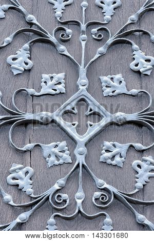 Wrought iron ornaments on a historic gate
