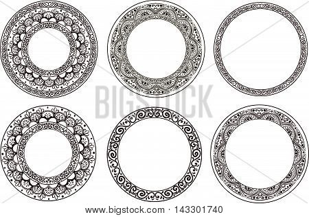 Set of five ornamental black floral round frames on a white background