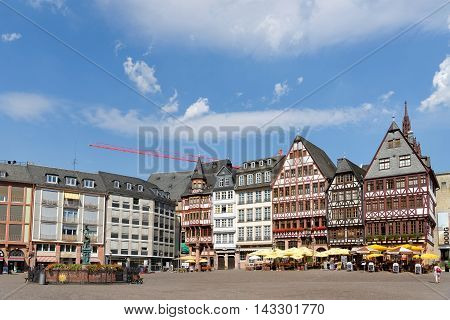 FRANKFURT AM MAIN GERMANY - AUGUST 7 2015: Romerberg square (Roman Mountain) the historic heart of the city and the centre of the old town.