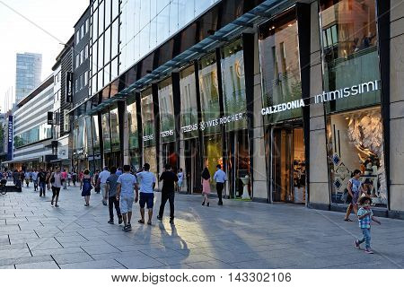 FRANKFURT AM MAIN GERMANY - AUGUST 7 2015: People walk along the Zeil. Since the 19th century it is of the most famous and busiest shopping street in Germany.