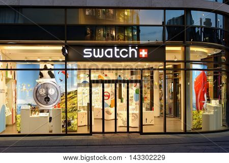 FRANKFURT AM MAIN GERMANY - AUGUST 7 2015: Swatch store on Zeil at night. Swatch SA founded in 1983 is specialized in watch manufacturing and one of the biggest brand names in the world.