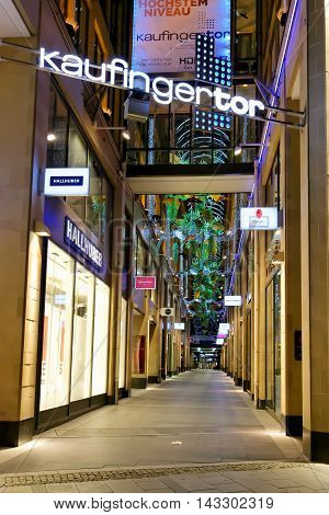 MUNICH GERMANY - AUGUST 2 2015: Kaufingertor shopping passage with arcade-shaped glass roofing. There once stood a town gate at the time of the first town wall over 800 years ago.